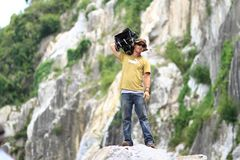Cameraman standing on rocky ledge Royalty Free Stock Photography