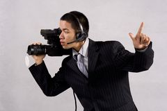 Cameraman take one. Cameraman on the shooting live entertainment royalty free stock images