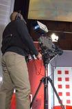 Cameraman in TV studio. Cameraman works in the studio royalty free stock photos