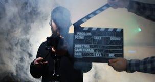 Film crew shooting take of scene in studio royalty free stock image