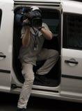 Cameraman in van. Cameraman sitting in van while filming Royalty Free Stock Photo