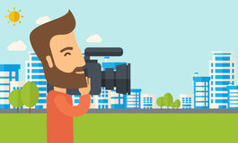 Cameraman with video camera Stock Photography