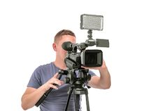 Video camera operator isolated on a white background. royalty free stock image