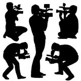 Cameraman with video camera. Silhouettes on white. Background. Vector illustration stock illustration