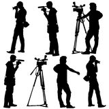 Cameraman with video camera. Silhouettes on white Royalty Free Stock Image
