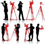 Cameraman with video camera. Silhouettes on white Stock Images