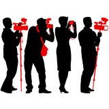Cameraman with video camera. Silhouettes on white background. Royalty Free Stock Photography
