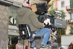 Cameraman. Video operator resumes sporting event Royalty Free Stock Images