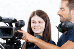 A cameraman and  woman with a movie camera Stock Photo