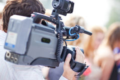 Cameraman at work. Shallow dof effect Stock Images