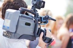 Cameraman at work. Shallow dof effect stock images