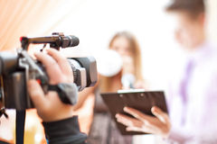 Cameraman at work. Shallow dof effect royalty free stock image