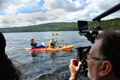 Cameraman at work. Cameraman and sound recordist at work on the lake Stock Photo
