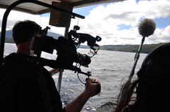 Cameraman at work. Cameraman and sound recordist at work on the lake Stock Photos