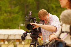 Cameraman at work. Cameraman and sound recordist at work on location stock images