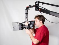 Cameraman work with crane. Cameraman look to the hd camcorder on the crane Royalty Free Stock Photos
