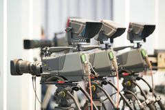 Cameraman work. digital Cameras ready to filming. Public broadcasting and tv show. Set of professional camera ready for cameraman operator filming work royalty free stock photography