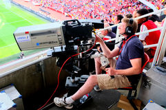 Cameraman at work during a live soccer game Royalty Free Stock Photo