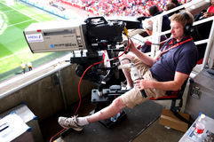 Cameraman at work during a live soccer game Royalty Free Stock Photos