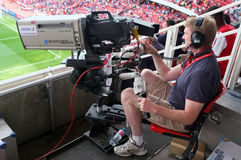 Cameraman at work during a live soccer game Stock Photos