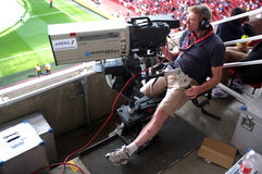Cameraman at work during a live soccer game Royalty Free Stock Photography