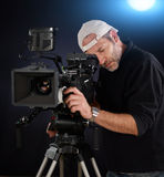 Cameraman working with a cinema camera Stock Photography