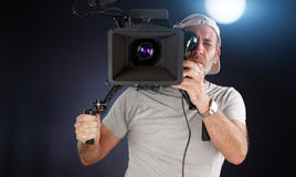 Cameraman working with a cinema camera Royalty Free Stock Photos