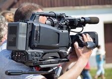 Cameraman is working Stock Photo