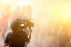 Cameraman Working. Portrait of cameraman working at stage royalty free stock photos