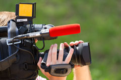 Cameraman working Stock Image