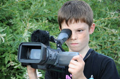 Cameraman. Young cameraman is shooting a movie stock photos