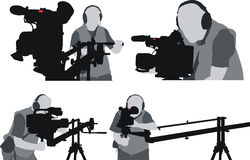 Cameramans silhouettes Stock Photography