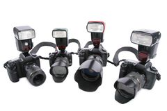 Cameras with flashes. On a white background in half circle Stock Image