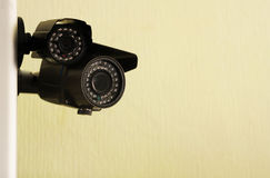 Cameras. Hang on the wall, and there are two outdoor surveillance cameras Stock Photography