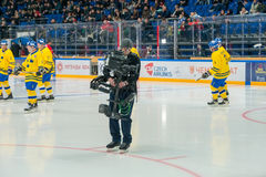 Cameras at hockey game Royalty Free Stock Photos