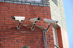 Cameras on the house. Royalty Free Stock Photos