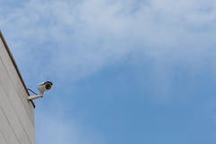 Cameras Surveillance against blue sky, idea for safety, protected object stock image