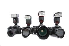 Cameras With Flashes On White Background Royalty Free Stock Photos