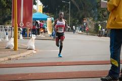 Camerati stuoie di sincronizzazione & del corridore maratona Fotografia Stock