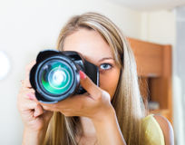 Camerawoman taking images indoor Stock Photography