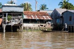 Camere sui trampoli nel delta del Mekong Fotografie Stock Libere da Diritti