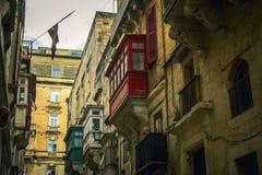 Camere tradizionali di architettura edifici maltesi tradizionali di Malta e destinati esotico del fondo di viaggio di concetto di Immagini Stock