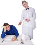 Cameriere ed ospite del ristorante Fotografia Stock