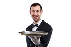 Cameriere Holding Tray Isolato sopra fondo bianco Maggiordomo sorridente immagini stock libere da diritti
