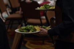 Cameriere With Salads sui piatti bianchi Immagine Stock Libera da Diritti