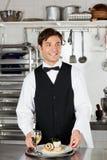 Cameriere With Salmon Roll And White Wine Immagine Stock Libera da Diritti