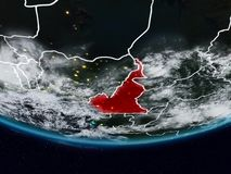 Cameroon during night. Cameroon on Earth at night with visible country borders. 3D illustration. Elements of this image furnished by NASA stock photography