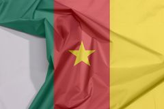 Cameroon fabric flag crepe and crease with white space. Cameroon fabric flag crepe and crease with white space, green red and yellow with a gold star stock photos