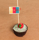 Cameroon flag on a apple cupcake Royalty Free Stock Photography