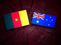 Cameroon. Flag with Australian flag on a tree stump Royalty Free Stock Photos